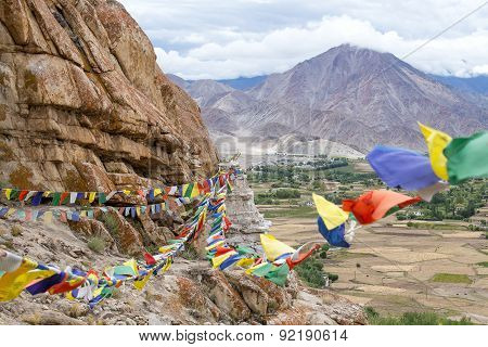 Plenty Of Colorful Buddhist Prayer Flags On The Stupa Near Takthok Gompa, Buddhist Monastery In Lada