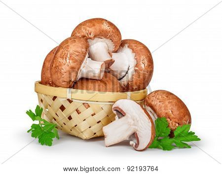 Fresh Mushrooms In A Basket With Parsley On An Isolated White Background