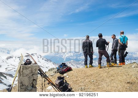 Alpinists On Top At High Altitude In The Alps