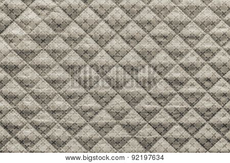 Beige Quilted Fabric With A Pattern From Crosses
