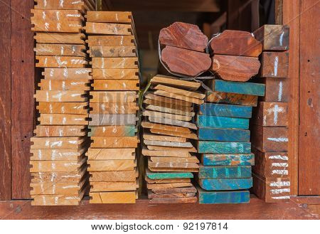 Pile Of Wood Stored In Stock On Shelf.