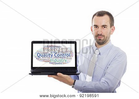 Businessman Holding Laptop With Quality Control Concept