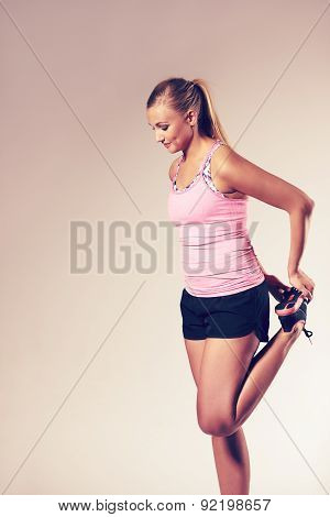 Woman Standing And Stretching Out Leg Muscles.