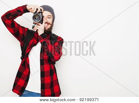 life style, tehnology and people concept: professional photographer. Portrait of confident young man in shirt  holding  camera over white background