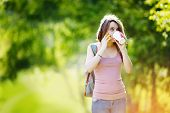 foto of no clothes  - Woman wearing casual clothes talking on phone and drinking beverage in disposable coffee cup - JPG