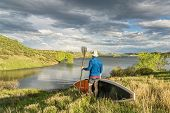 stock photo of horsetooth reservoir  - male paddler with stand up paddleboard  - JPG