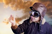image of bomber jacket  - Boy dressed up in pilot outfit at sunset sky - JPG