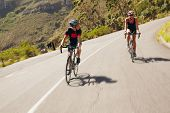 stock photo of triathlon  - Two cyclist practicing for triathlon race - JPG