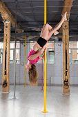 pic of upside  - Sporty woman posing upside down on pylon - JPG