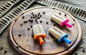 picture of gelato  - Coffee Popsicles With Coffee Grains On The Wooden Board - JPG