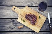 Постер, плакат: Bbq Steak Barbecue Grilled Beef Steak Meat With Red Wine And Knife