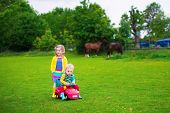 image of child feeding  - Family on a horse farm in summer - JPG