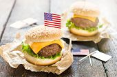 foto of burger  - Mini beef burgers with American flag on wooden backgoundselective focus - JPG