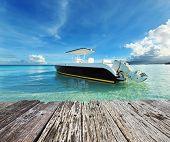 stock photo of boracay  - Beautiful beach with motor boat at Boracay island - JPG