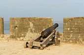 stock photo of fortified wall  - Cannon on walls of the Portuguese fort in the Diu town in Gujarat - JPG