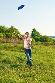 picture of frisbee  - Girl playing frisbee in the park in summer - JPG