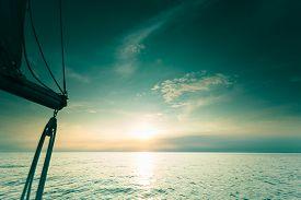 stock photo of yacht  - Yachting yacht sailboat sailing in baltic sea at sunset sunrise summer vacation - JPG