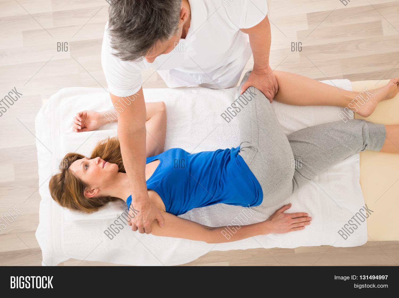 masseur doing massage on mature image photo bigstock. Black Bedroom Furniture Sets. Home Design Ideas