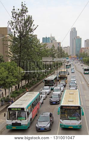 Buses And Cars Are Moving On The Road In Kunming, China