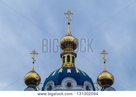 dome with a cross on top of the temple