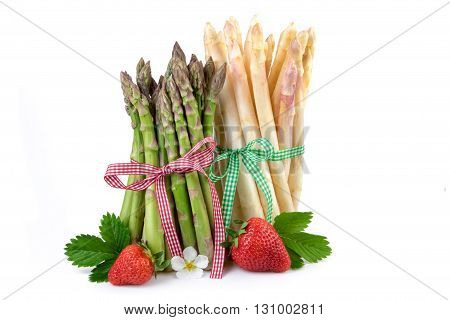 Bundle of green and white asparagus with strawberry. Fresh healthy vegetables on white background.
