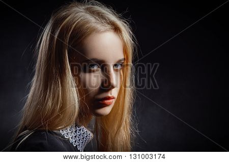 sad girl crying on black background monochrome