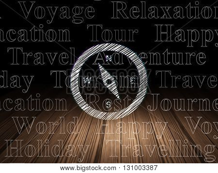 Travel concept: Glowing Compass icon in grunge dark room with Wooden Floor, black background with  Tag Cloud