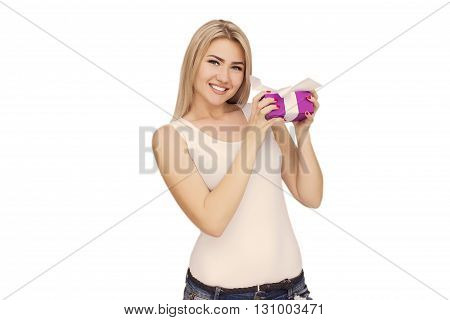 Young woman portrait holding gift on white