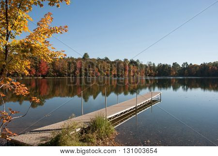 Reflection of autumn forest in the lake Dunbar town beach Marinette county Wisconsin