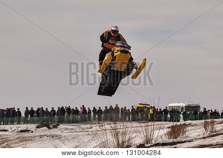 Tyumen, Russia - March 08. 2008: IV stage of personal-team Championship of Ural Federal district in over-snow cross-country. Jumping of sportsman on snowmobile