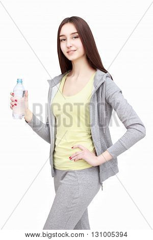 Portrait of smiling fitness young woman drinking water