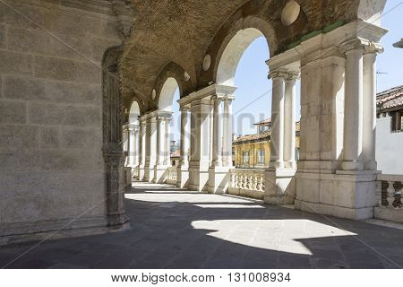 VICENZA-APRIL 3,2015:view of the famous colonnade of the Palladian basilica in the center of Vicenza during a sunny day.