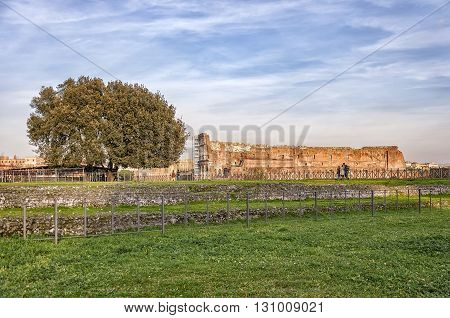 The ancient ruin of the Roman Colosseum amphitheater situated in the Italien capital of Rome.