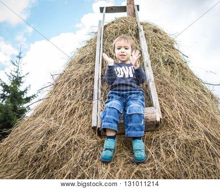 Back to nature enjoy, kid on hay