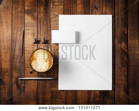 Blank branding identity set on wooden table background. Corporate identity template. For design presentations and portfolios.