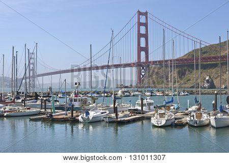The Golden gate bridge and marina in marine layer.