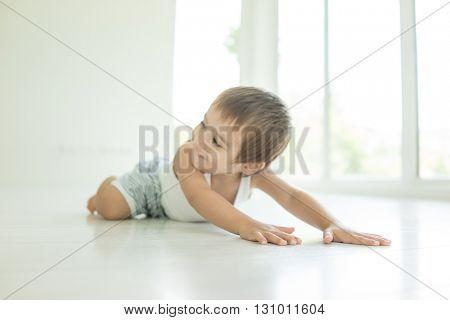 Child lying down on floor