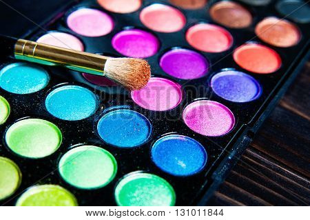 Makeup palette with makeup brush. Makeup background