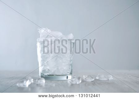 Isolated Whiskey Rox Glass Full Of Crashed Ice Cubes On Wooden Table White Backgroundhigh Key Image