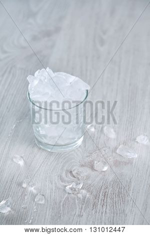 Isolated Whiskey Rox Glass Full Of Crashed Ice Cubes On Wooden Table White Backgroundhigh Key Image,