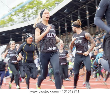 STOCKHOLM SWEDEN - MAY 14 2016: Lots of runners after the start in the obstacle race Tough Viking Event in Sweden April 14 2016