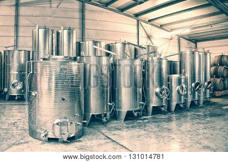 Fermentation stainless steel vats in a winery, toned