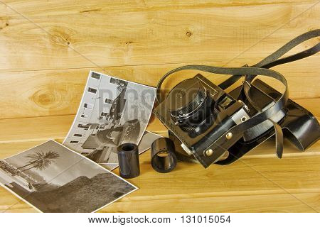 Cameras film photo album and on the surface of wood