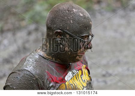 STOCKHOLM SWEDEN - MAY 14 2016: Man wearing glasses covered with mud in the obstacle race Tough Viking Event in Sweden April 14 2016
