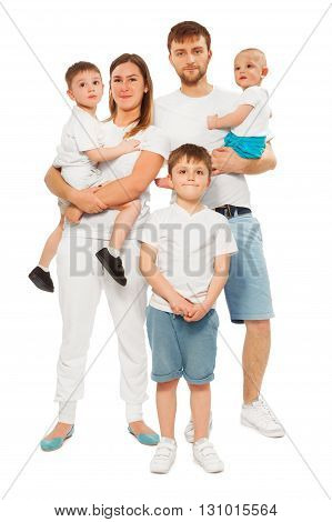 Full height picture of happy big family, mother, father and three age-diverse children, isolated on white