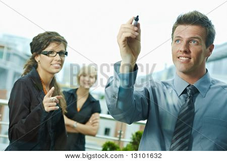 Business team planning, businessman thinking drawing diagram on window. Outdoor of office on terrace.