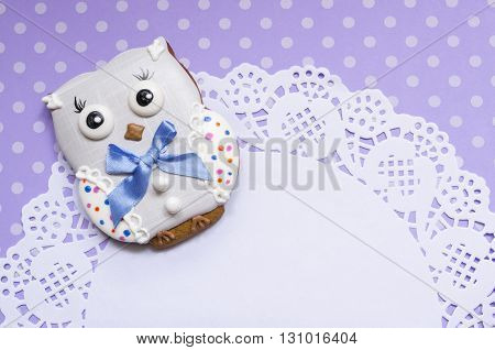 A cute polka dot background with a handmade honey-cake owl and a beautiful napkin with a place for your text for a baby shower party, a birthday party or other events.