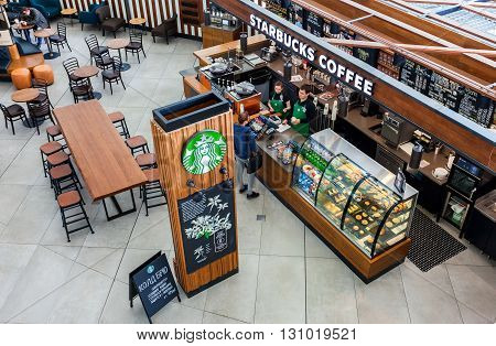 SAMARA RUSSIA - MAY 22 2016: Starbucks cafe interior in Samara airport Kurumoch. Starbucks Corporation is an American global coffee company and coffeehouse chai