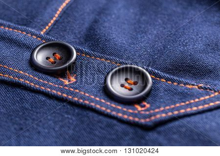 Blue jeans skirt with design buttons, close up