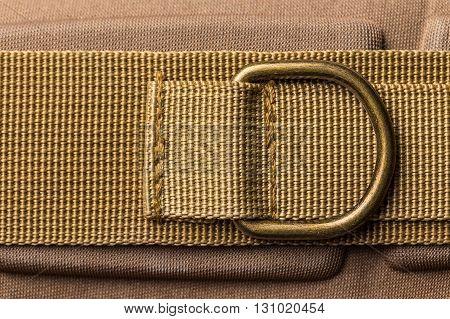 Metal ring on brown fabric, close up shot